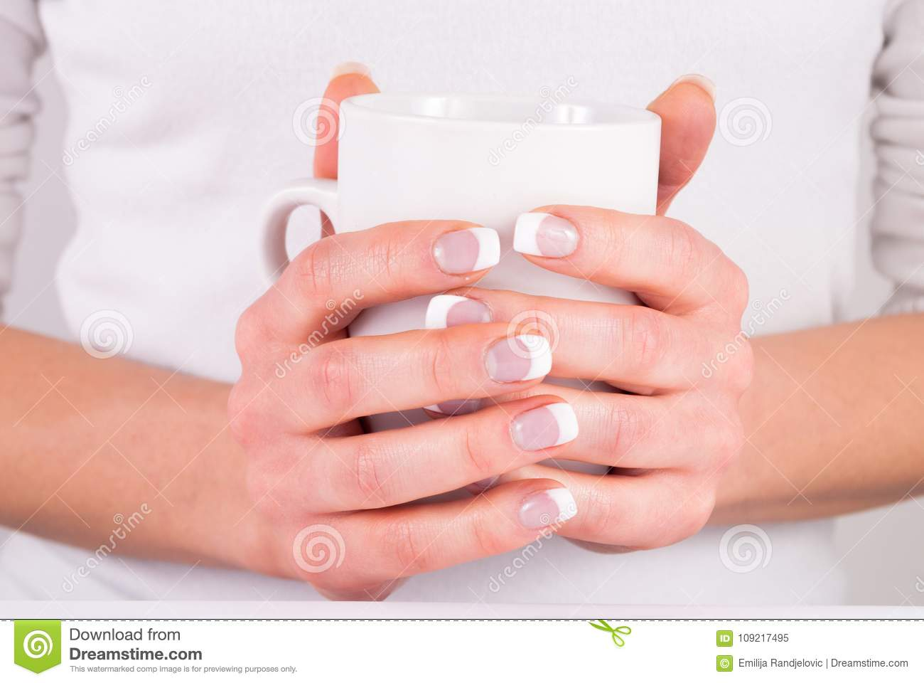 Woman Hands With French Nails Manicure Holding Cup Of Coffee Stock ...