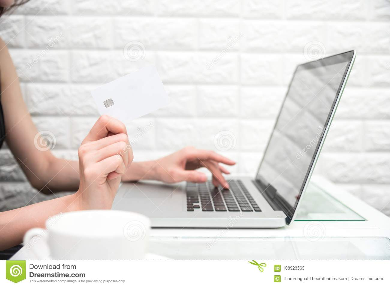 Woman hands holding credit card for online shopping or ordering