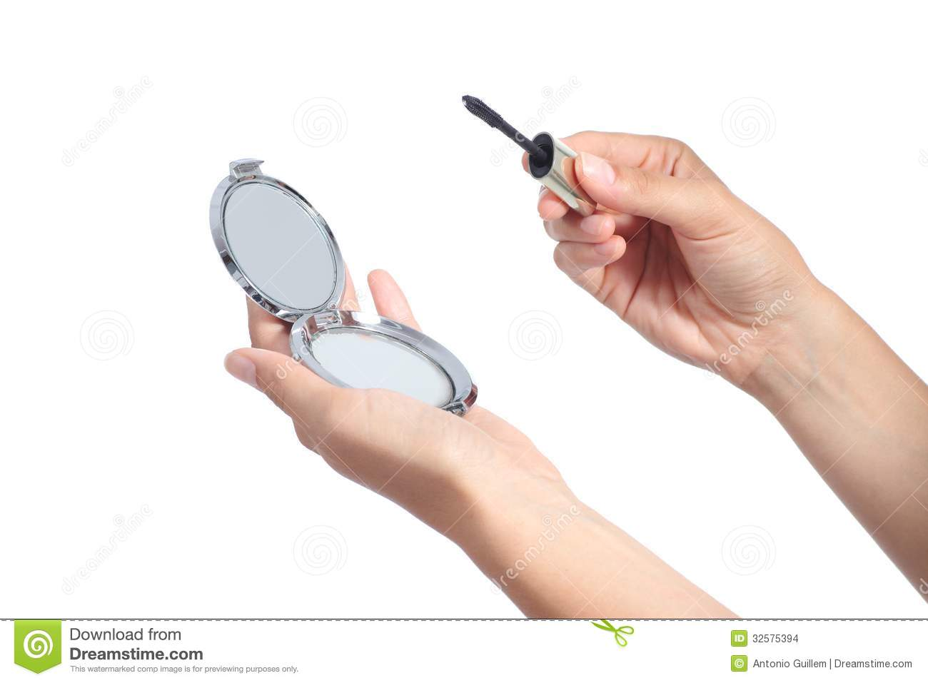 Woman Hands Holding A Hand Mirror And A Lash Mascara Ready