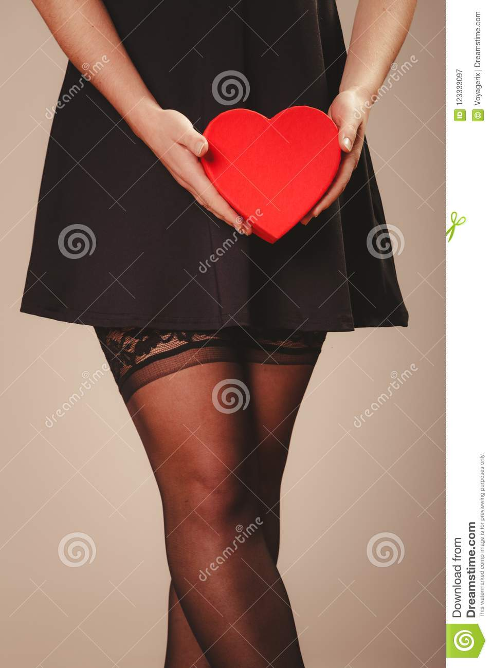 3a8cda899 Woman hands holding heart stock image. Image of sexuality - 123333097
