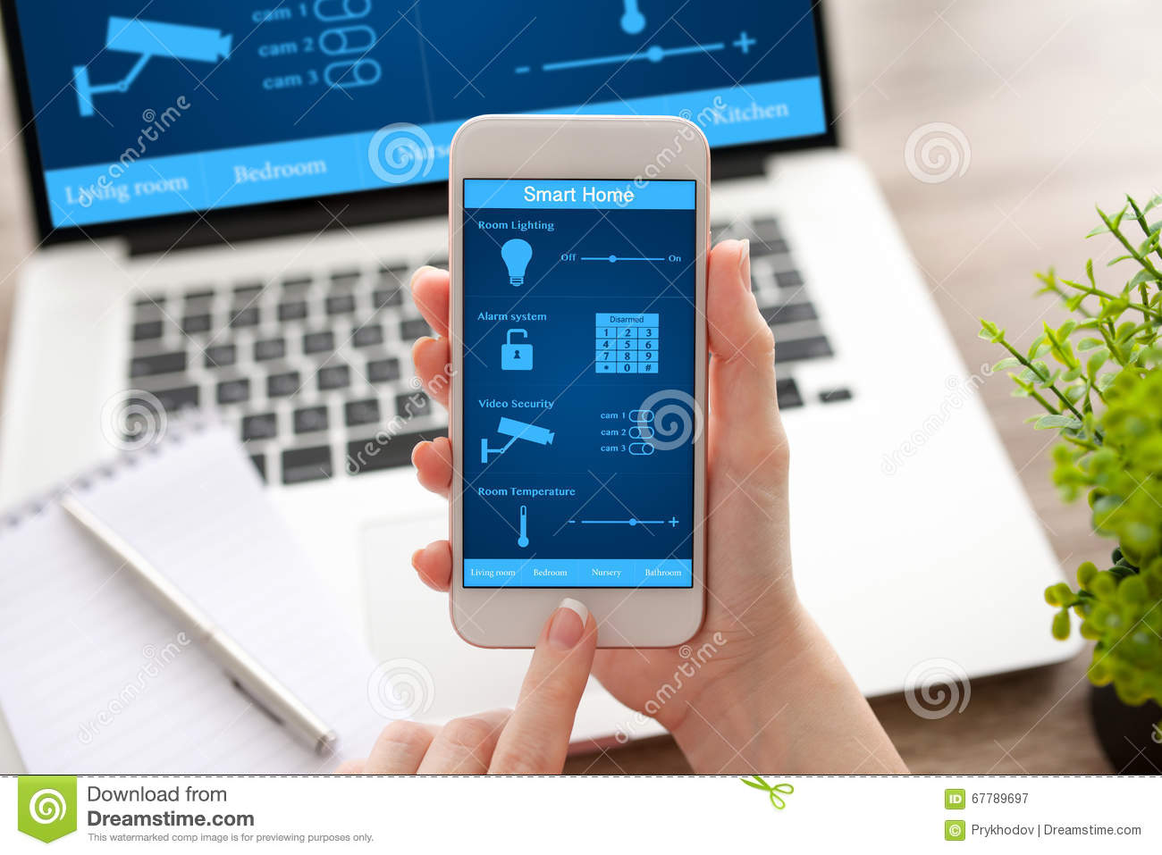 Smart House Phone woman hands holding phone and notebook with app smart home stock