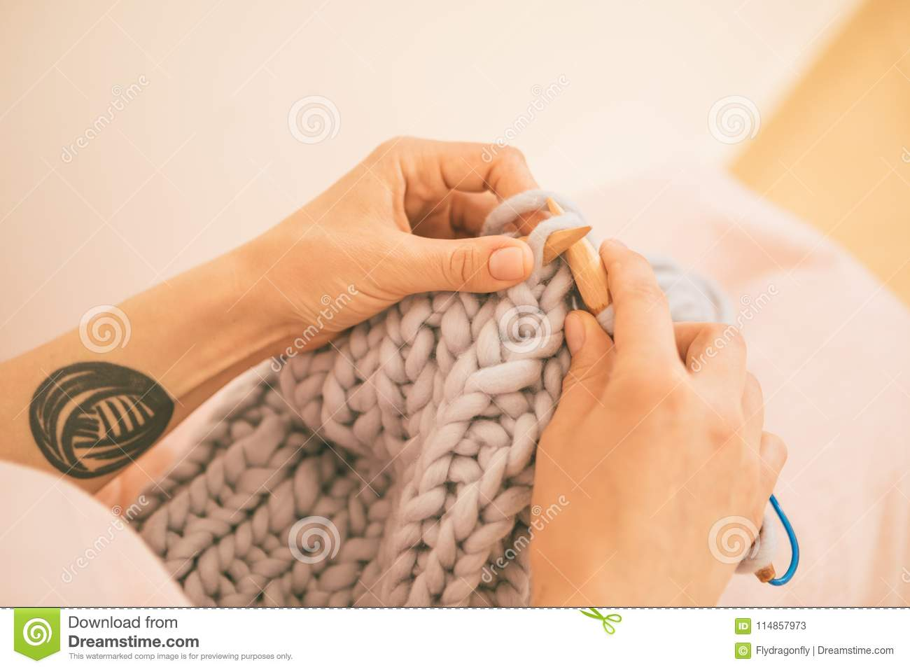Woman hands knitting needles. hobby crafts things. Top view. Horizontal composition. Pink warm colors. New mainstream