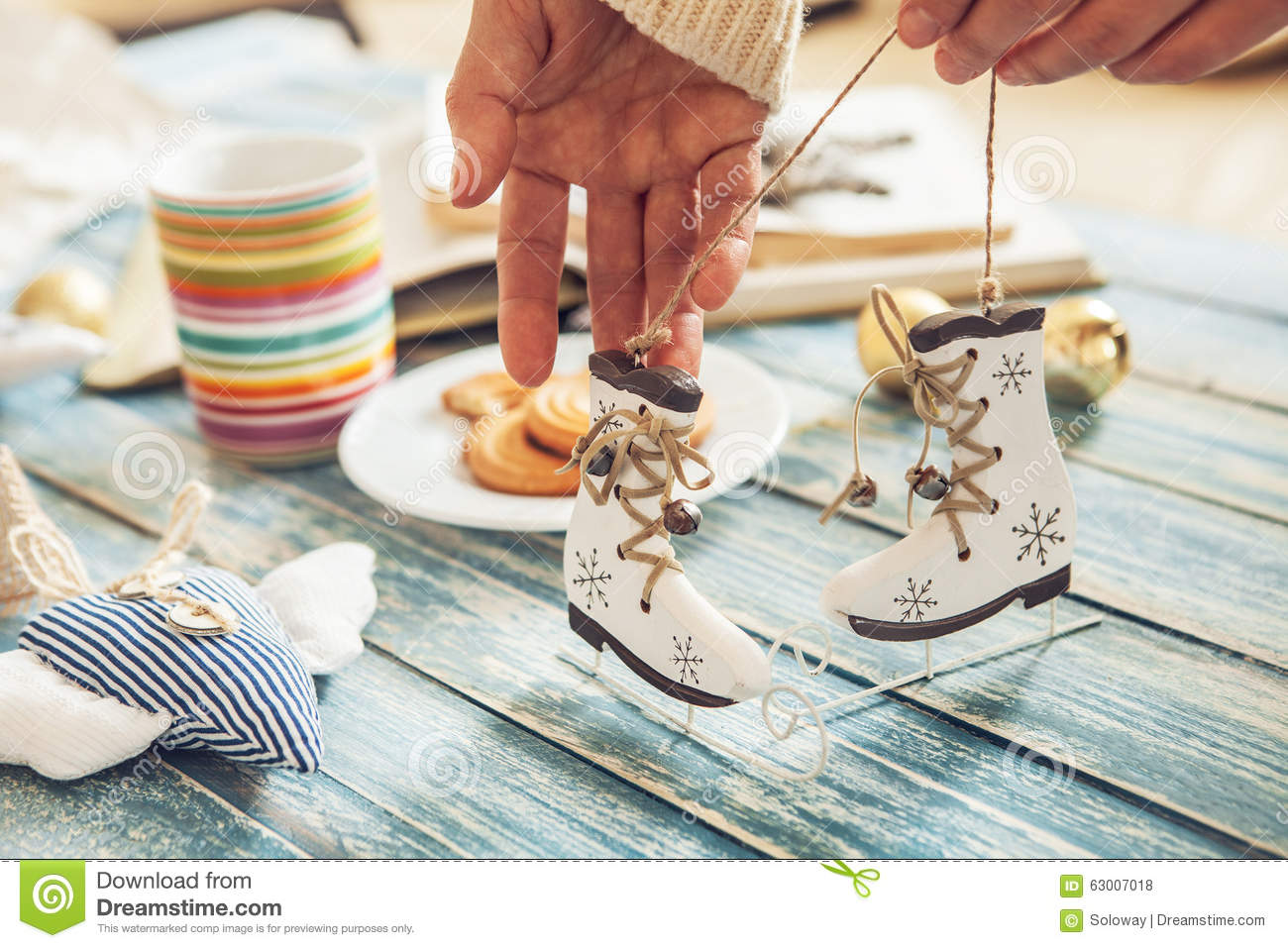Woman Hands With Miniature Ice Skates Christmas Tree