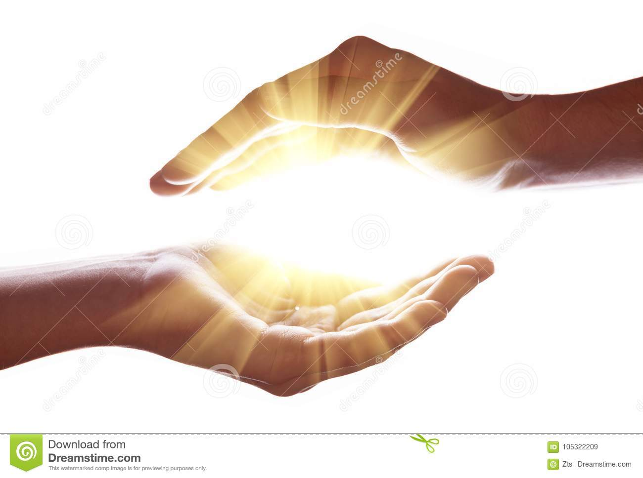 Woman hands protecting and containing bright, glowing, radiant, shining light. Emitting rays or beams expanding of center.