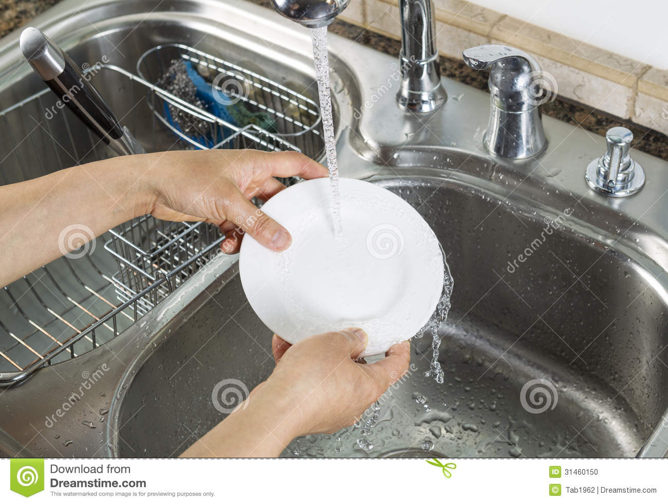 Woman Hands Washing Dinner Plate In Kitchen Sink Stock