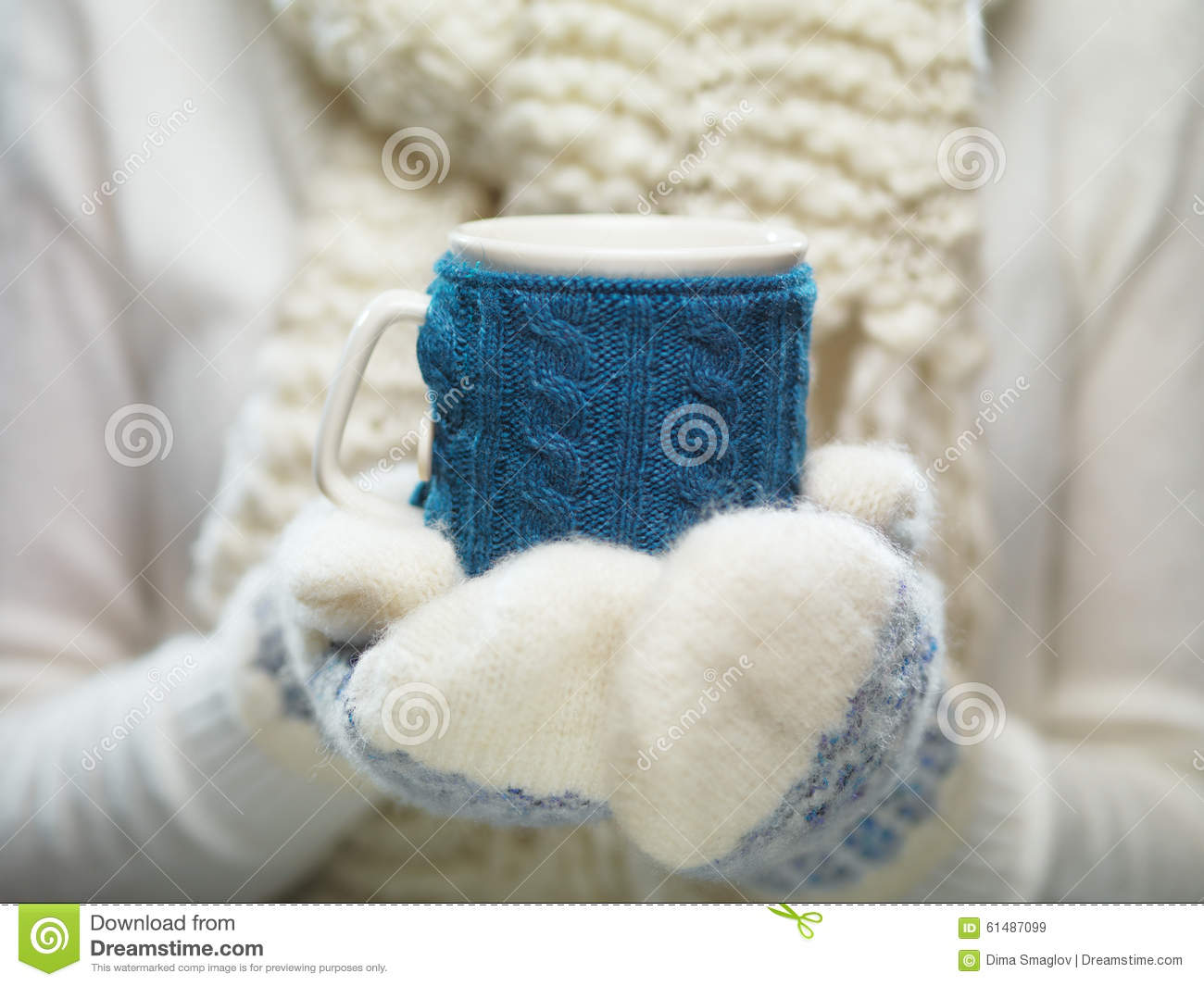 Knitting Pattern For Hand Holding Mittens : Woman Hands In White And Blue Mittens Holding A Cozy Knitted Cup With Hot Coc...