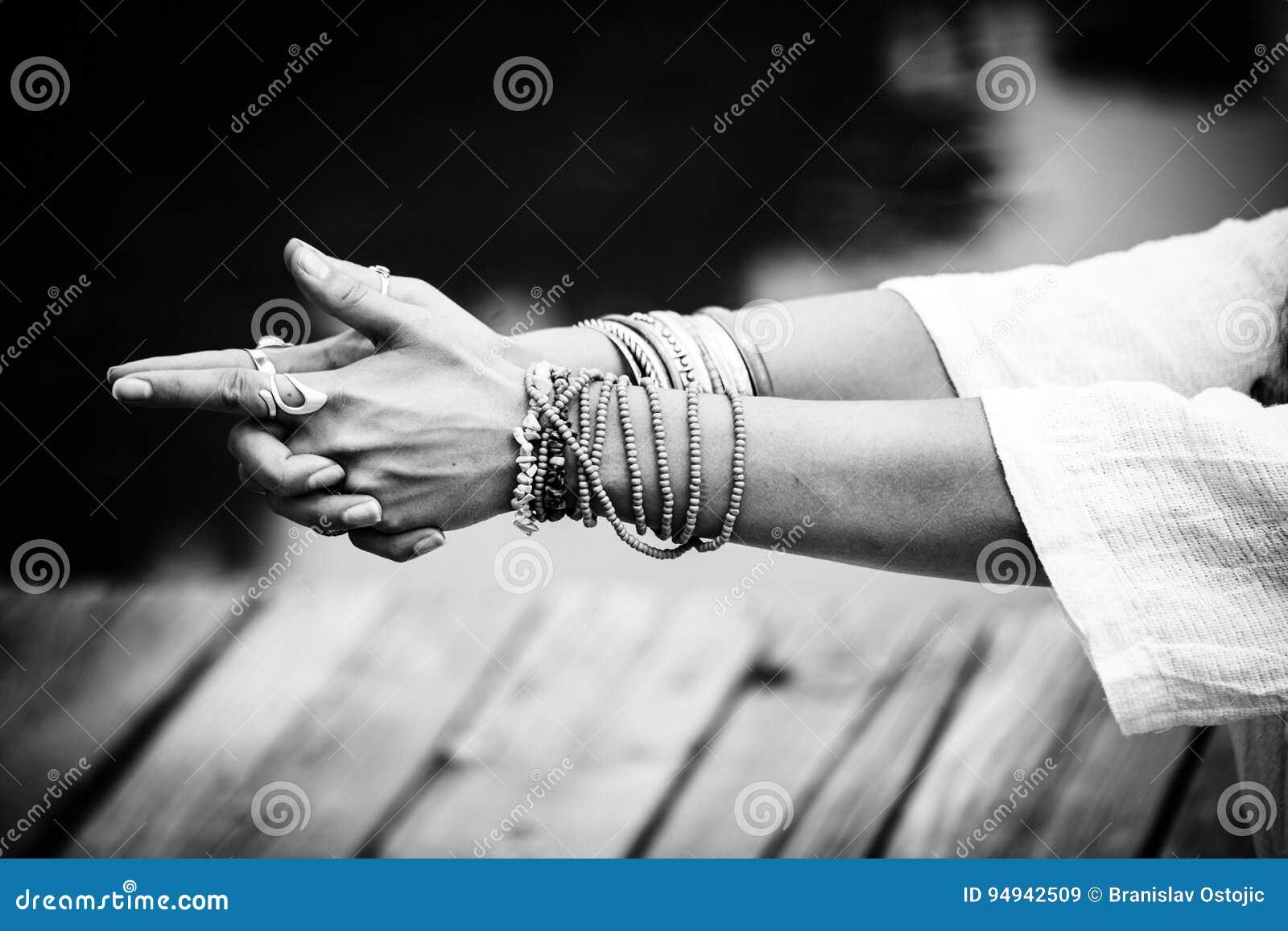 Woman hands in yoga symbolic gesture mudra bw
