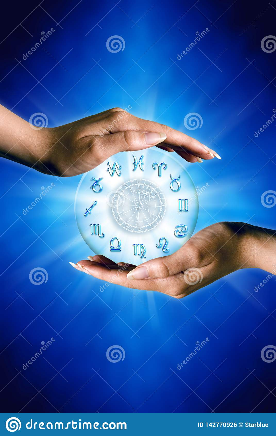 Woman hands with zodiac symbols and horoscope like astrology concept over blue background