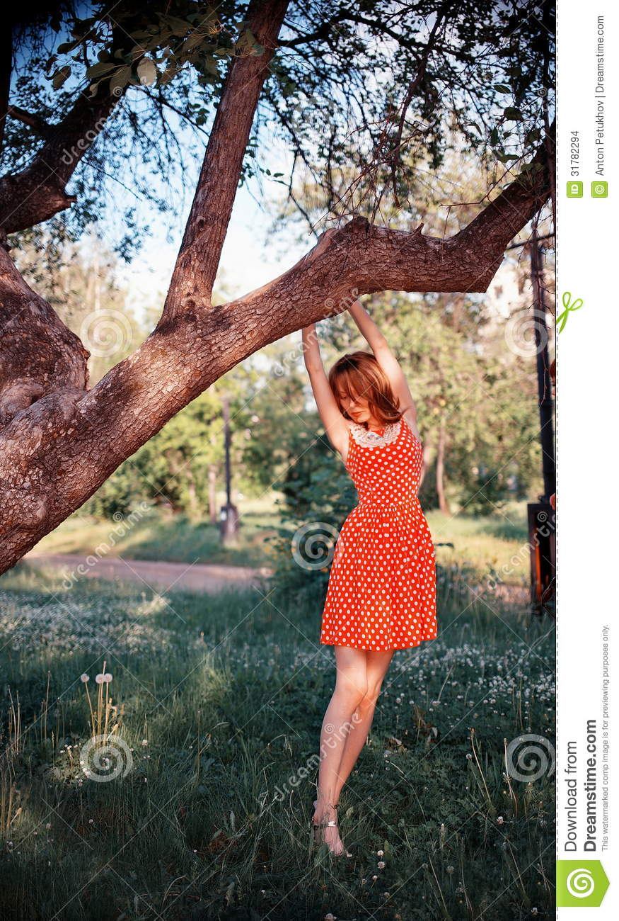 Woman Hanging From Tree Stock Images - Image: 31782294
