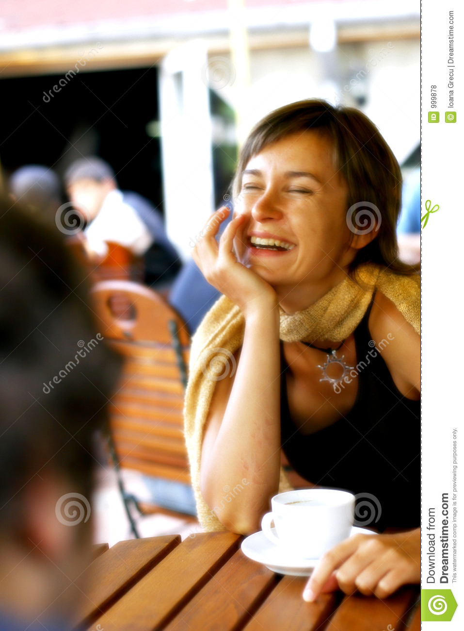 Woman in a happy conversation at coffee