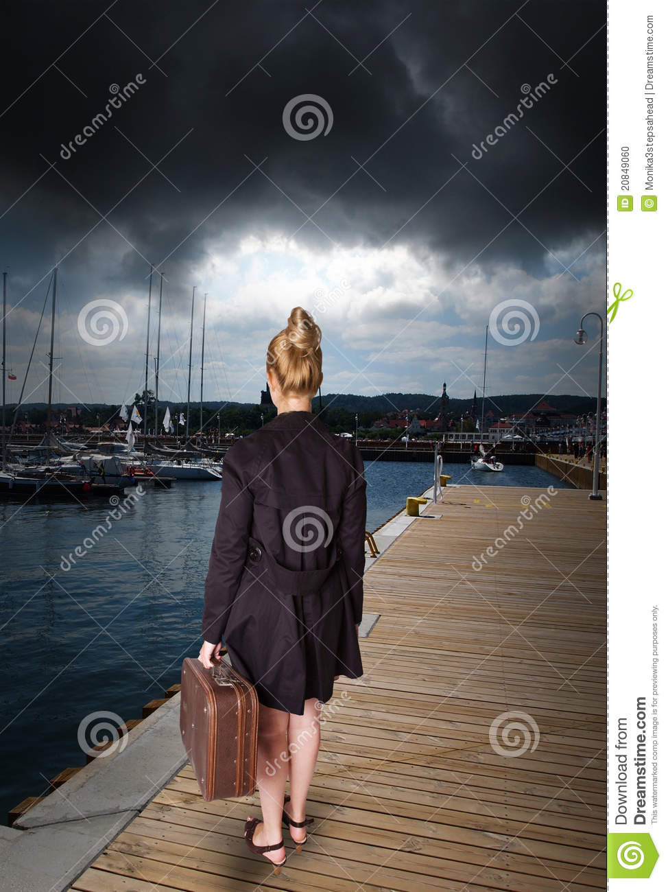 Woman at harbor - before storm