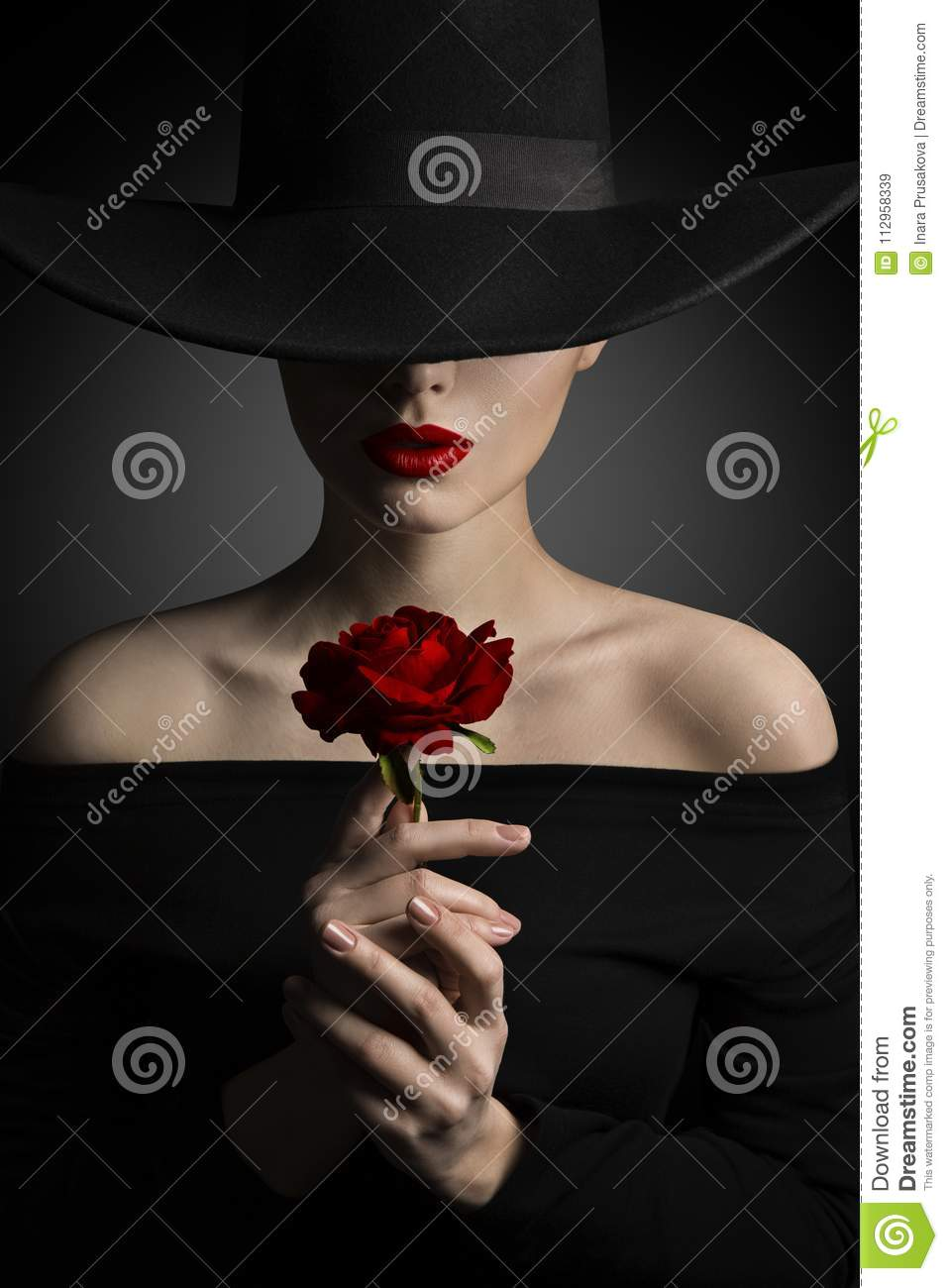 Woman in Hat holding Rose Flower in Hands, Fashion Model Beauty