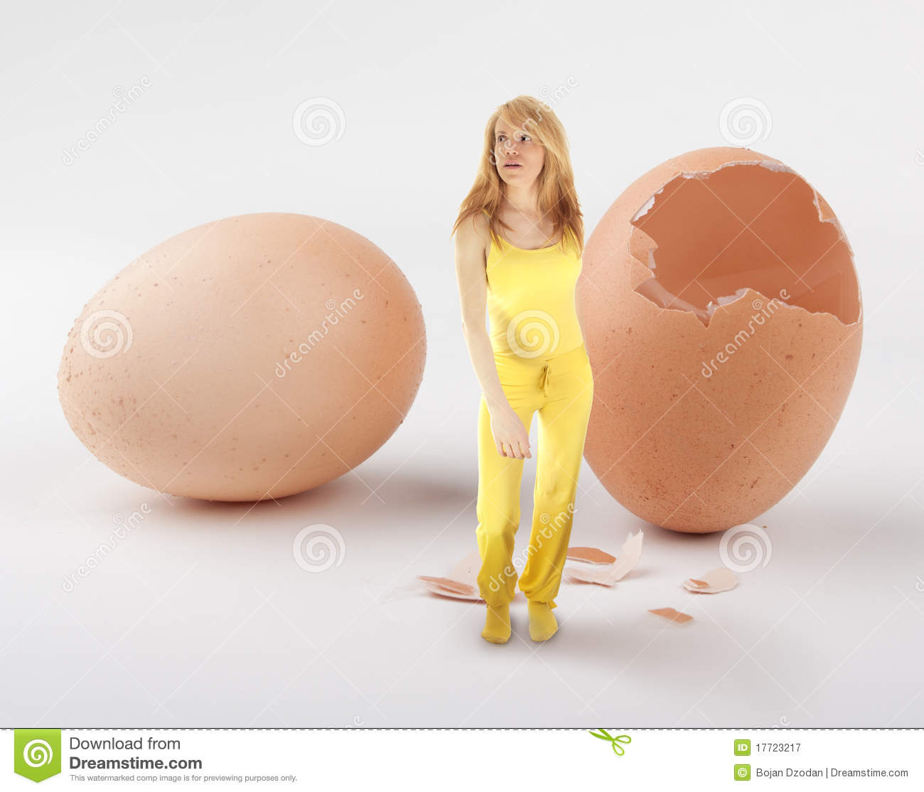 Woman hatching from egg