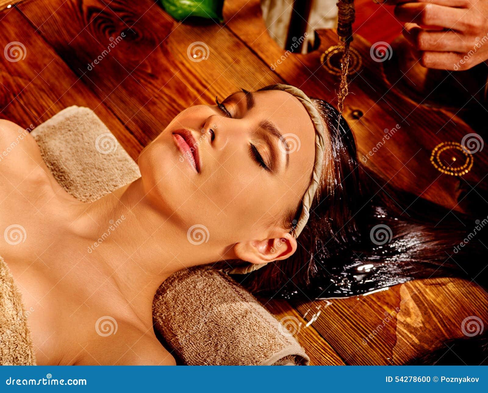 Woman having Ayurvedic spa treatment