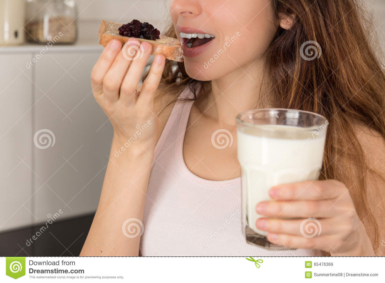 Woman having breakfast with a glass of milk
