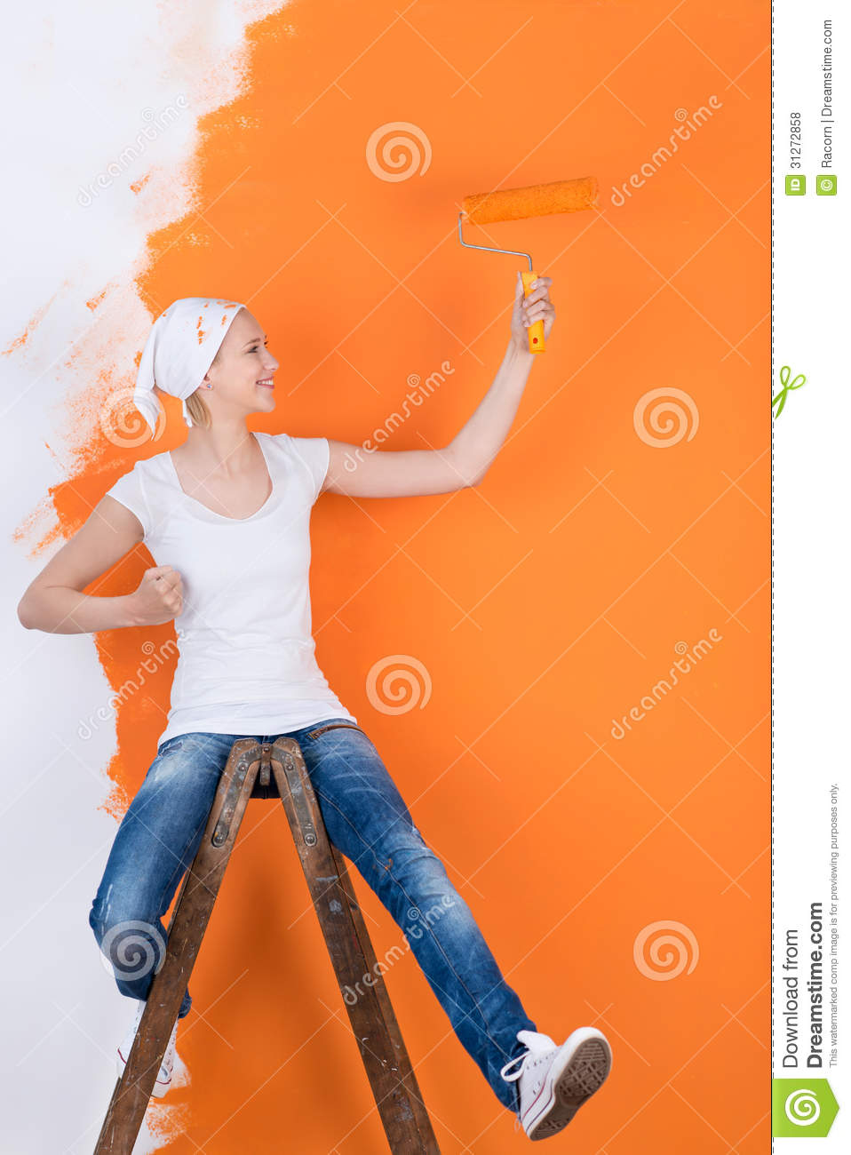 woman having fun while painting stock photo