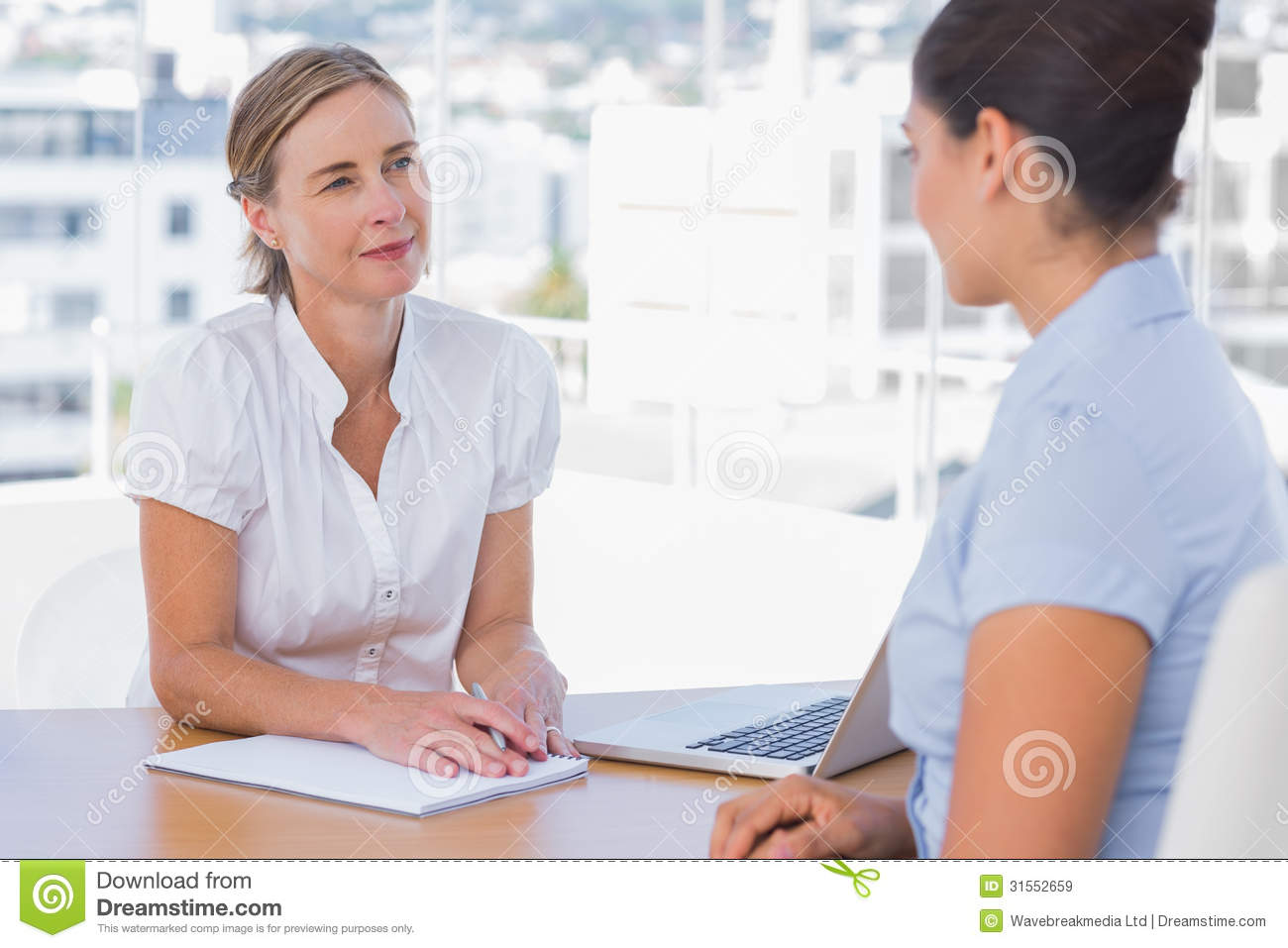 Woman Having A Job Interview With A Businesswoman Royalty