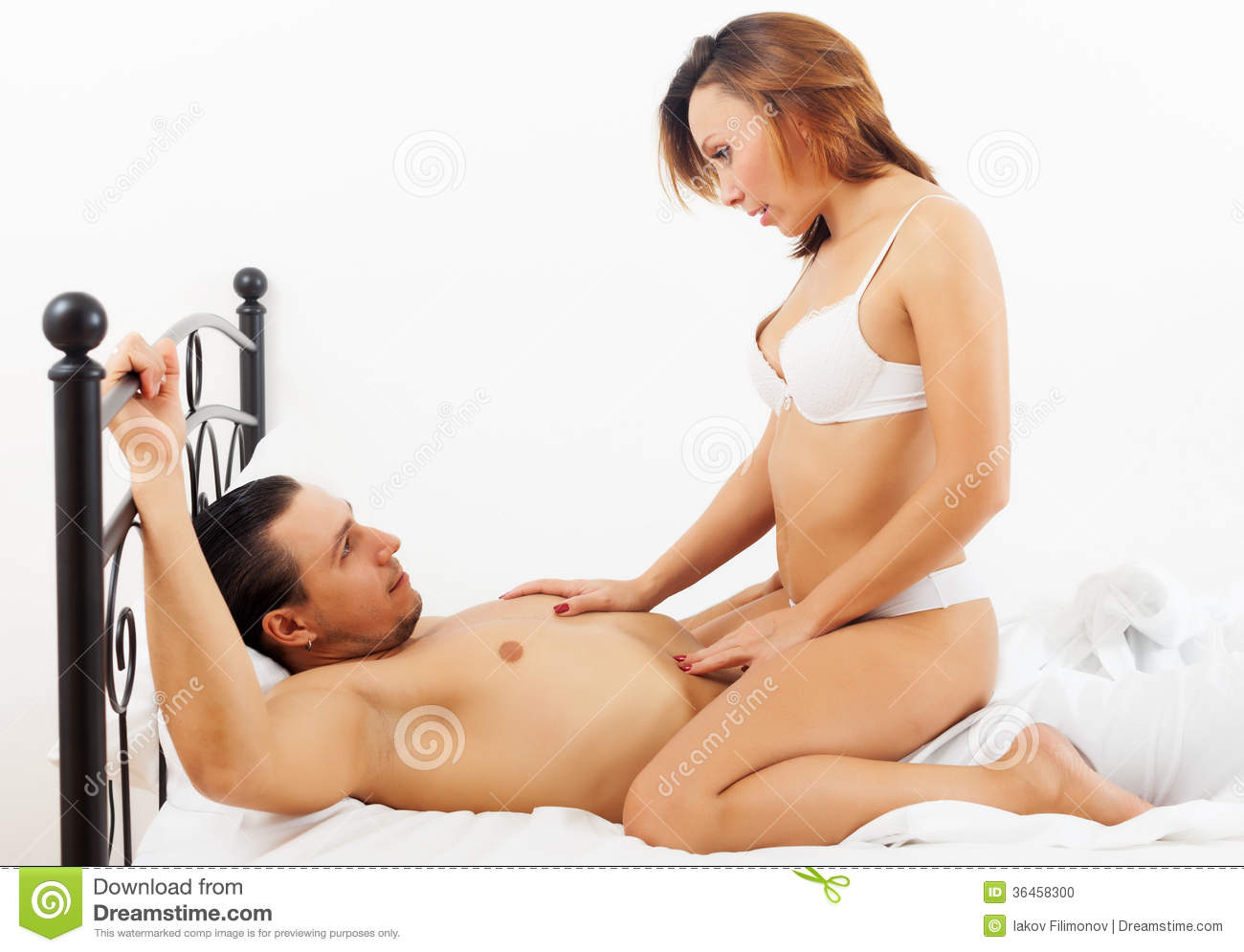 man and woman fucking in the bed naked