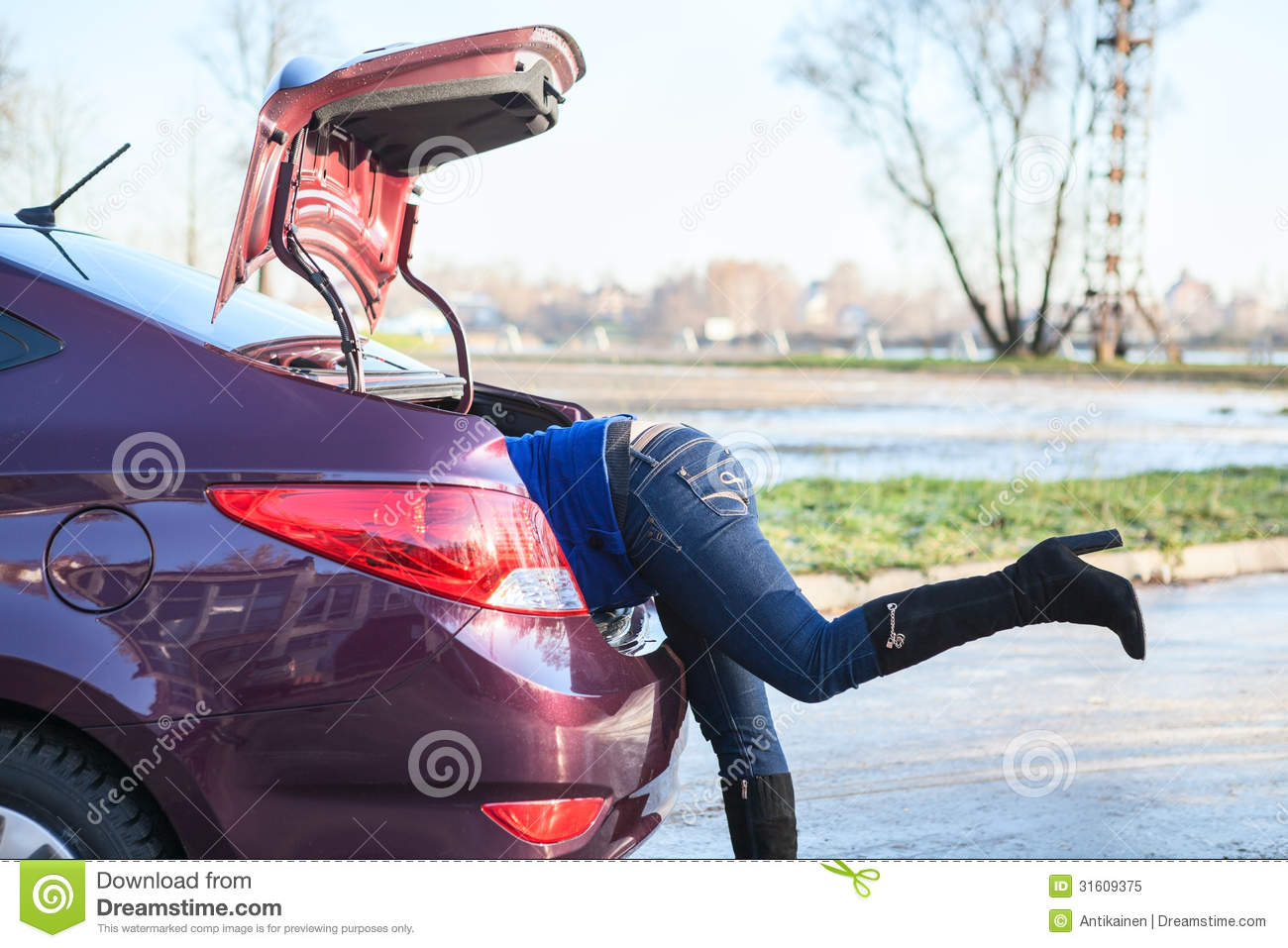 woman with head getting into the opened car trunk royalty free stock photo image 31609375. Black Bedroom Furniture Sets. Home Design Ideas