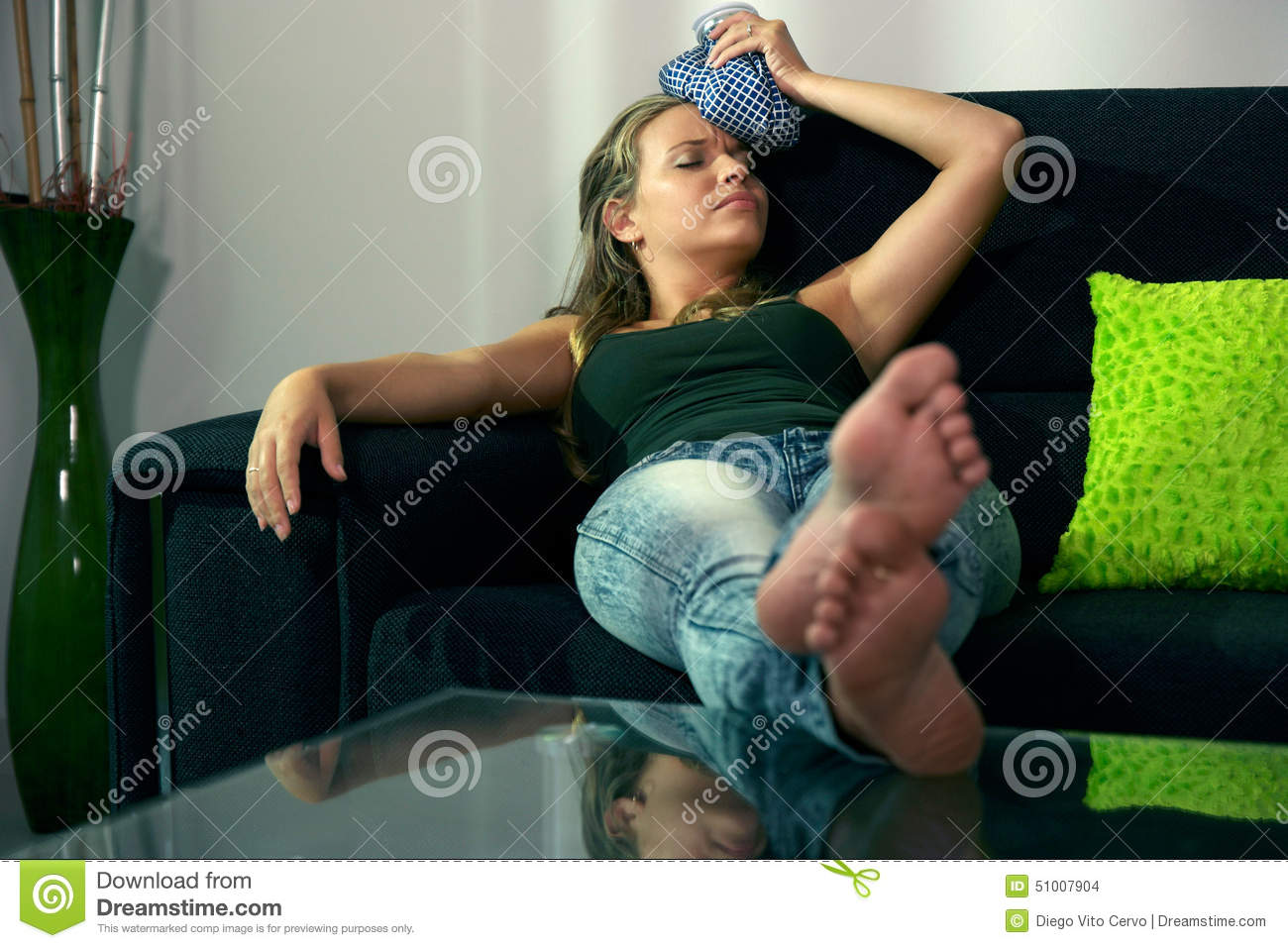 Woman With Headache Sitting On Sofa With Ice Bag On Head  : woman headache sitting sofa ice bag head young hispanic girl feeling tired laying home relaxing feet table 51007904 from www.dreamstime.com size 1300 x 957 jpeg 146kB