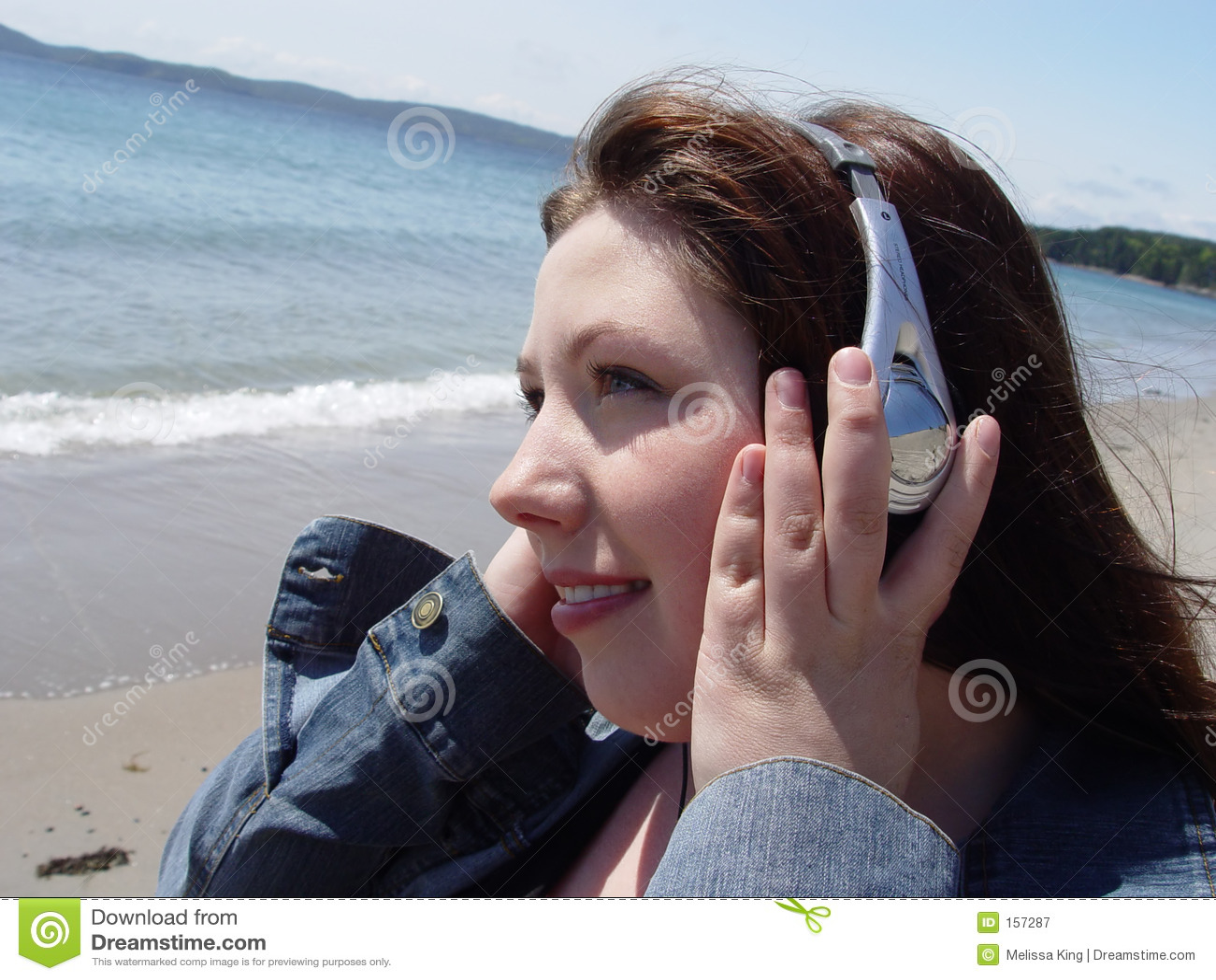 Woman in headphones on beach