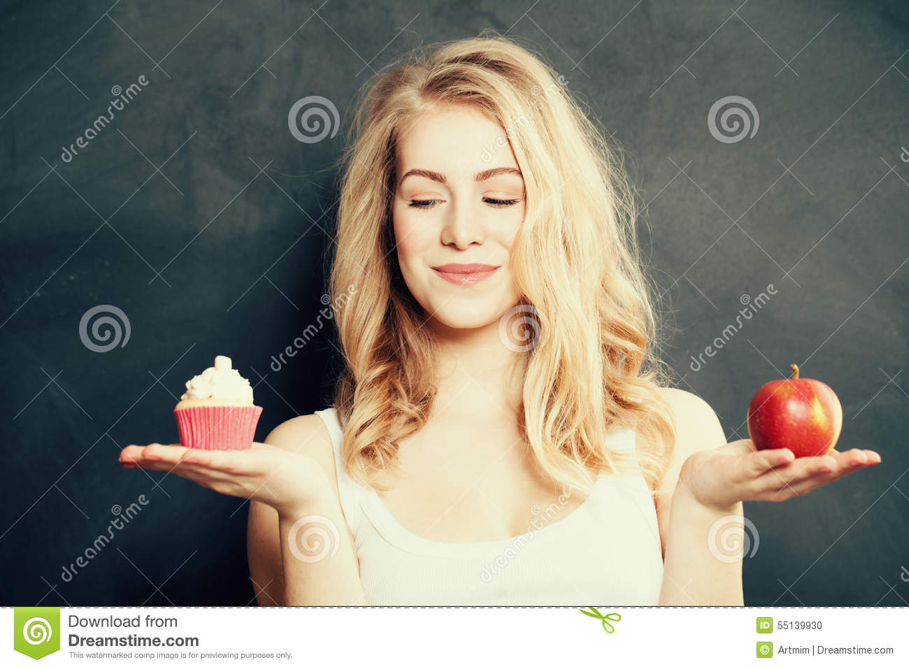 Woman with Healthy and Unhealthy Food. Difficult choice