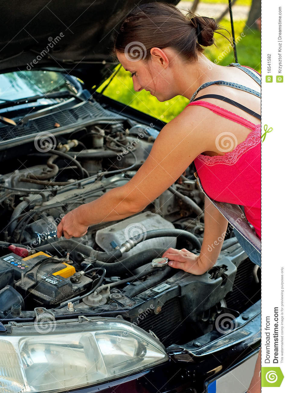 Broken Down Car With Warning Triangle Royalty Free Stock: Woman With Her Broken Down Car Stock Photo
