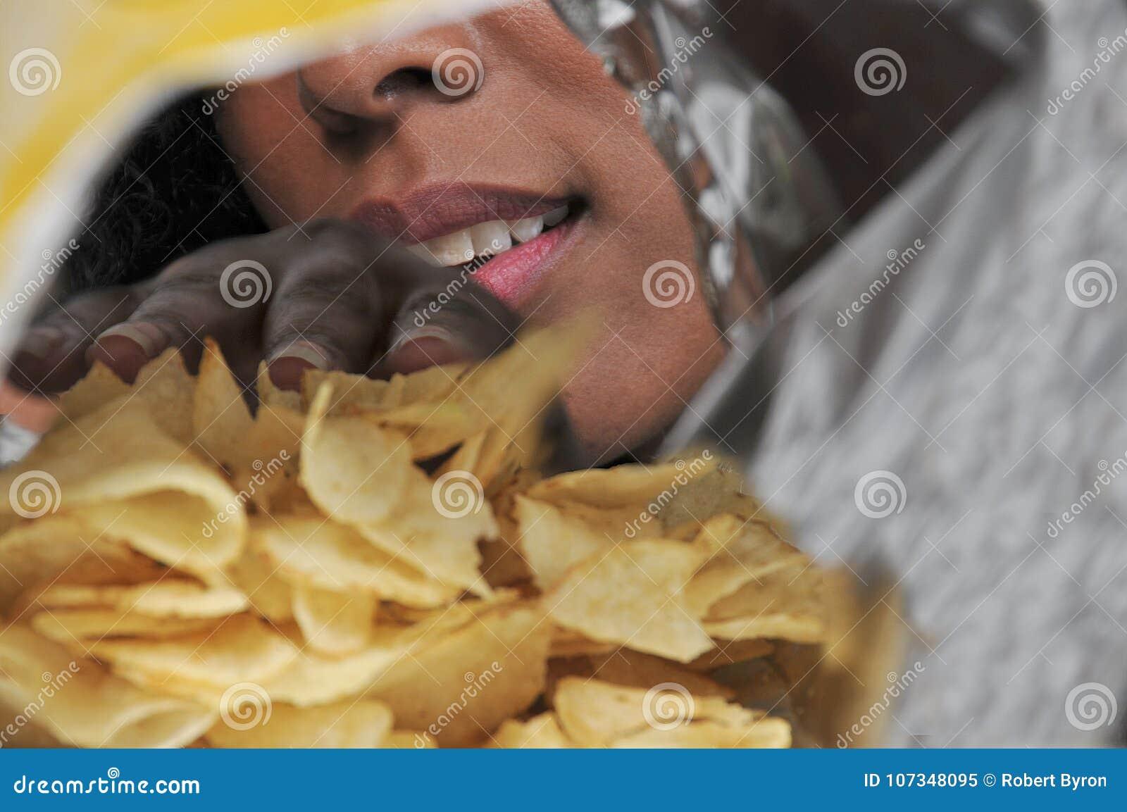 Woman eating potato chips
