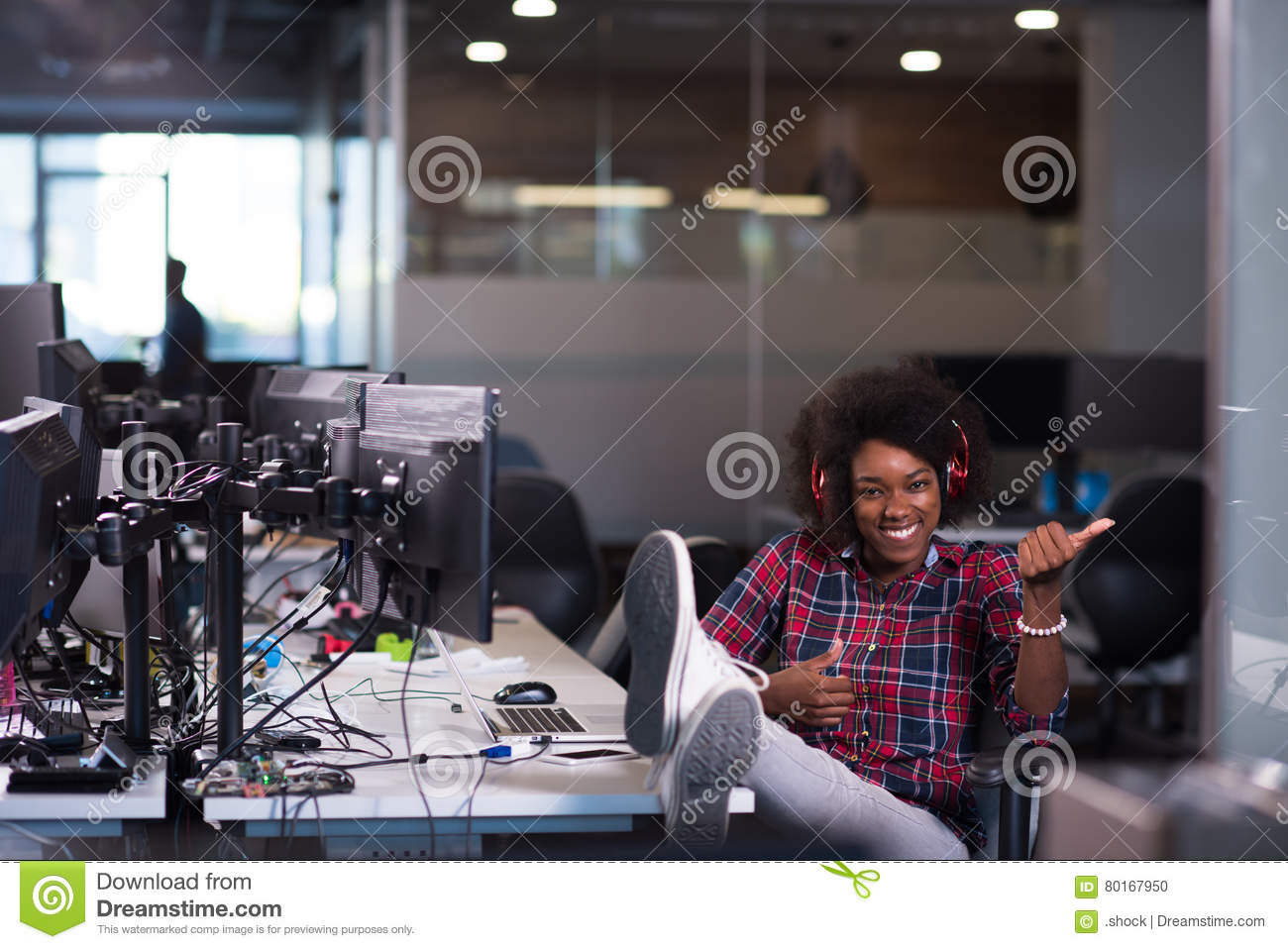Download Woman At Her Workplace In Startup Business Office Listening Musi Stock Photo - Image of girl, cheerful: 80167950