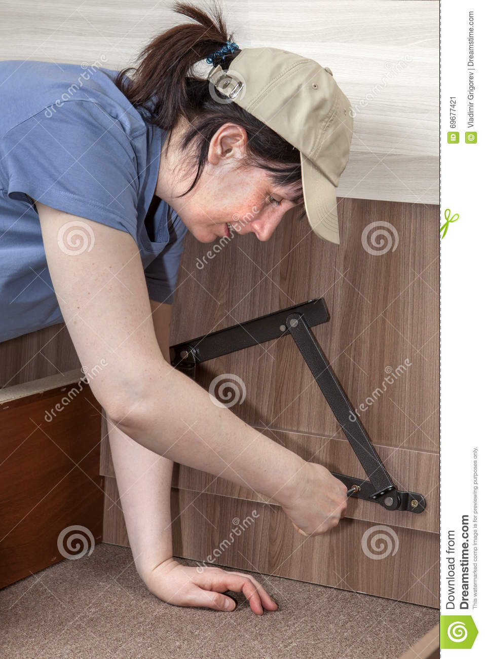 Woman Herself Assembles Furniture, She Screws Lifting Bed Hinge