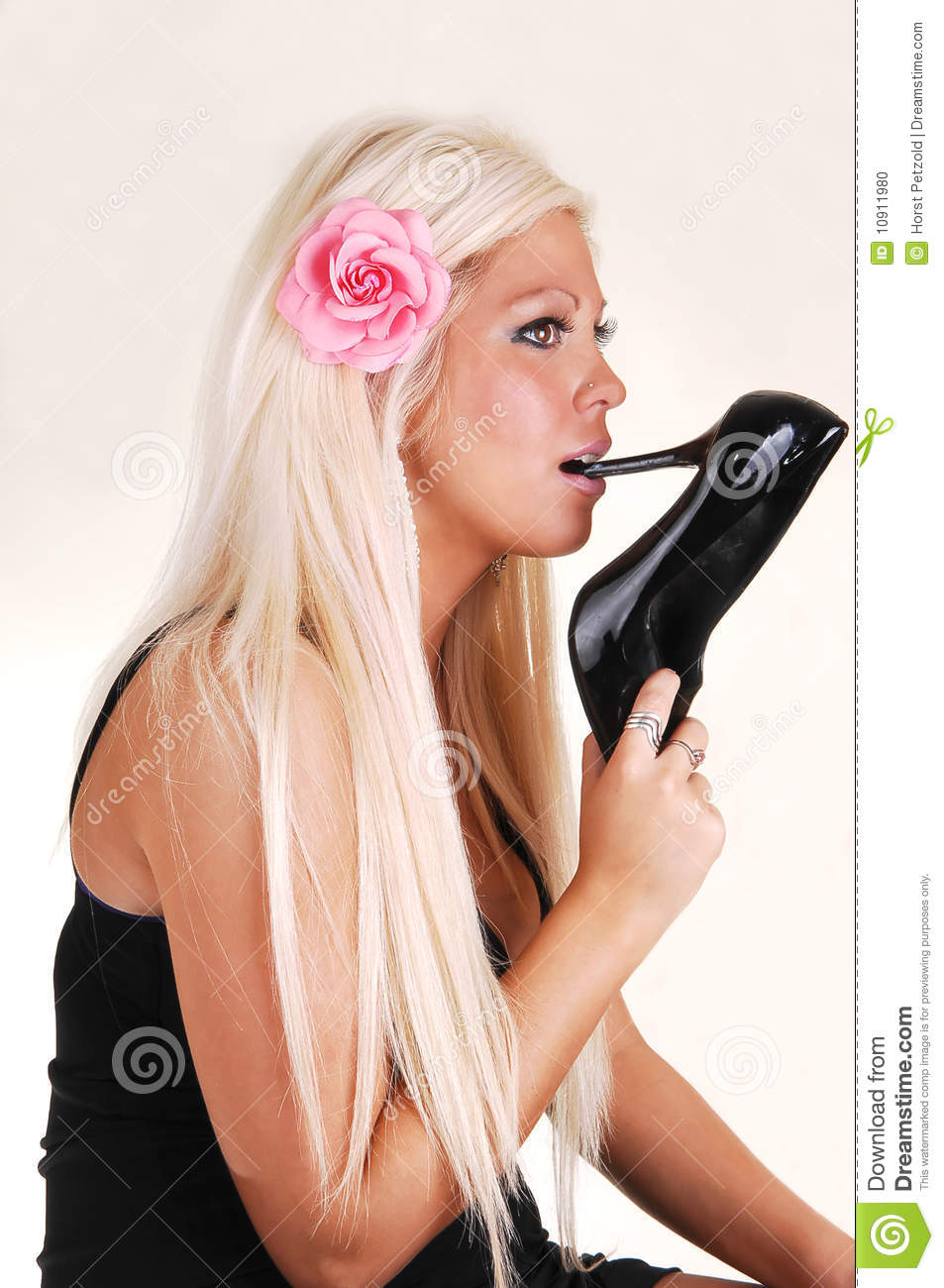 Woman With High Heel In Mouth. Stock Photo - Image: 10911980