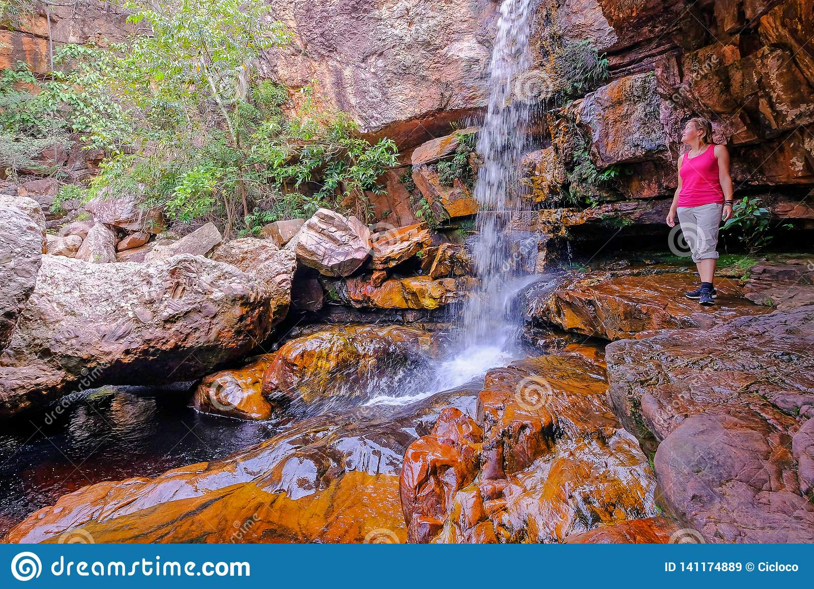 Woman hiker at Cachoeira Da Primavera, Spring Waterfall, Rio Lencois river, Chapada Diamantina National Park, Brazil
