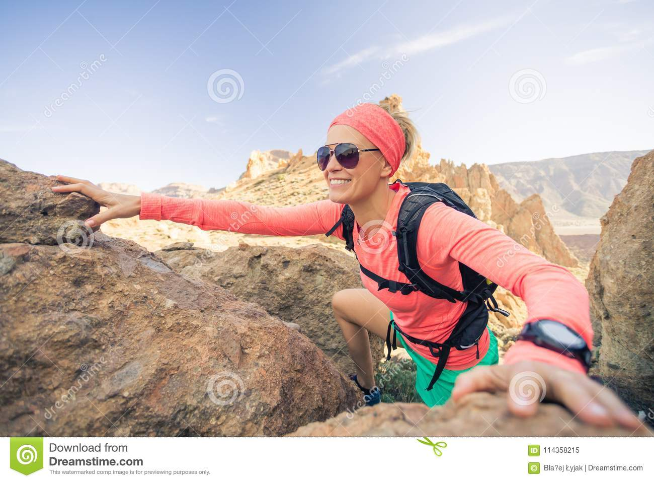 66fe6e2f631 Woman hiker reached mountain top. Inspiration and motivation for weekend  adventures. Female runner or climber looking at inspirational landscape on  rocky ...