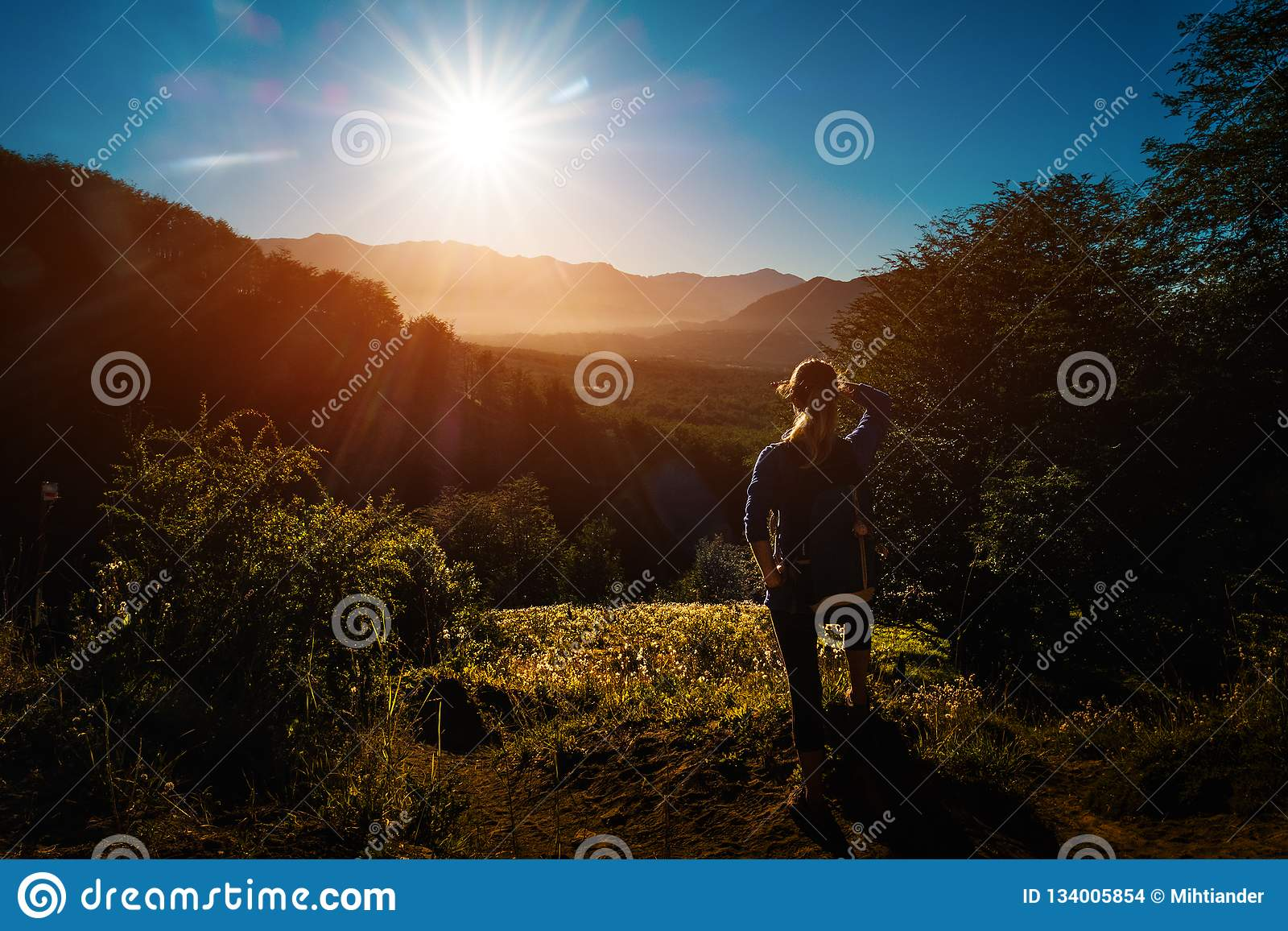 Woman hiker enjoys sunrise