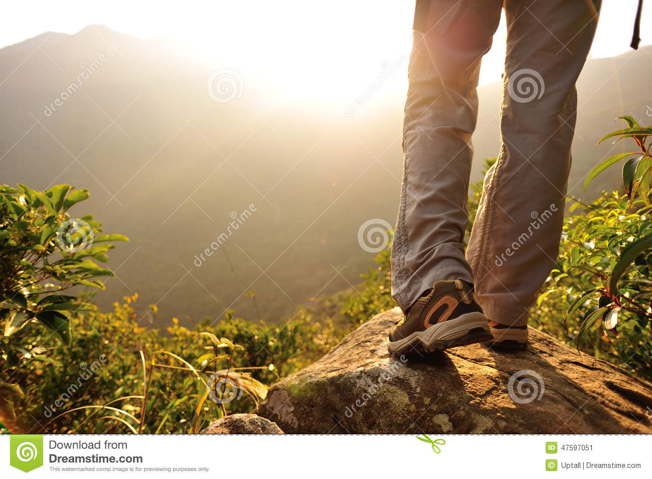 Woman hiker hiking stand on cliff