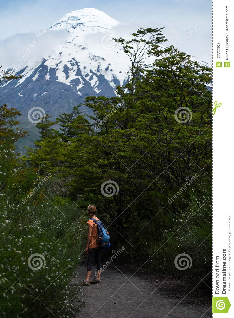 Woman hiker stands on the path