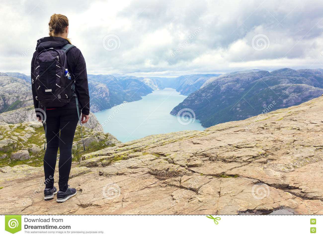Woman hiking at the pulpit rock in lysefjorden Norway
