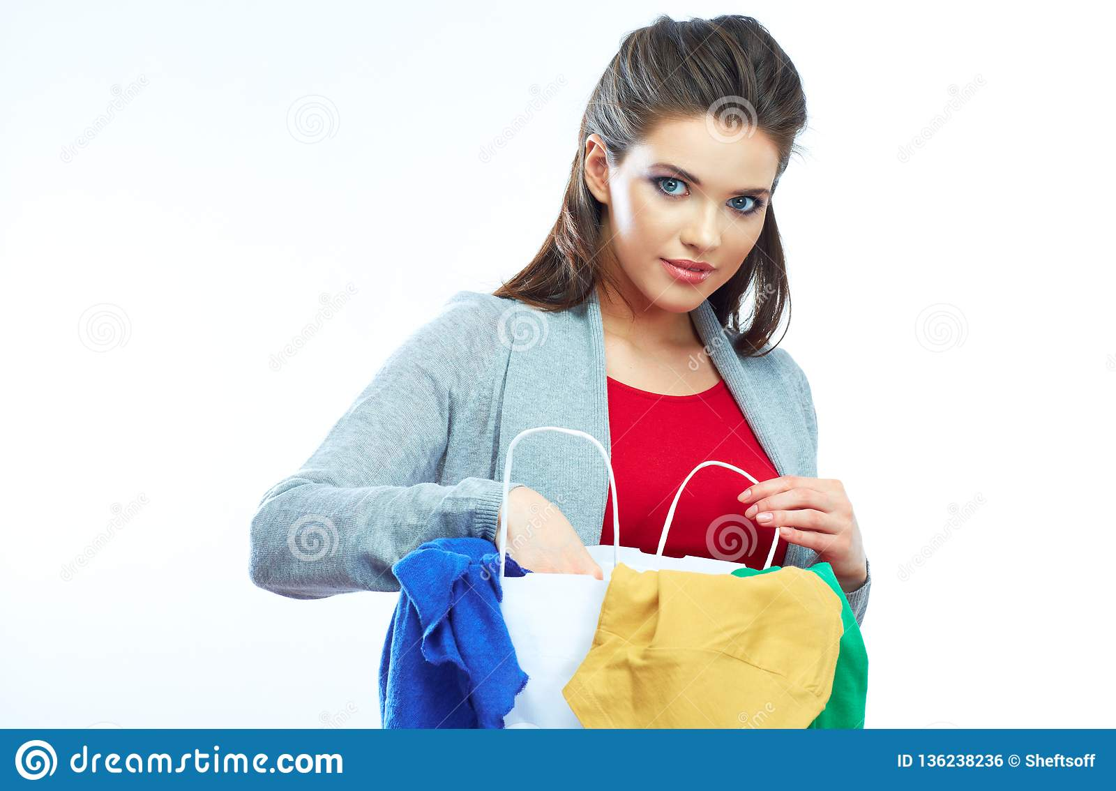 Woman hold shopping bags isolated on white background