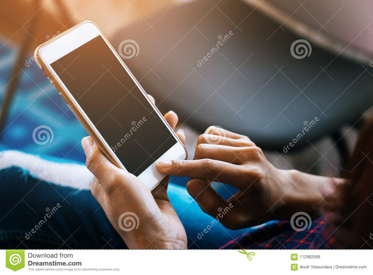 Woman touching blank mobile screen for mock up