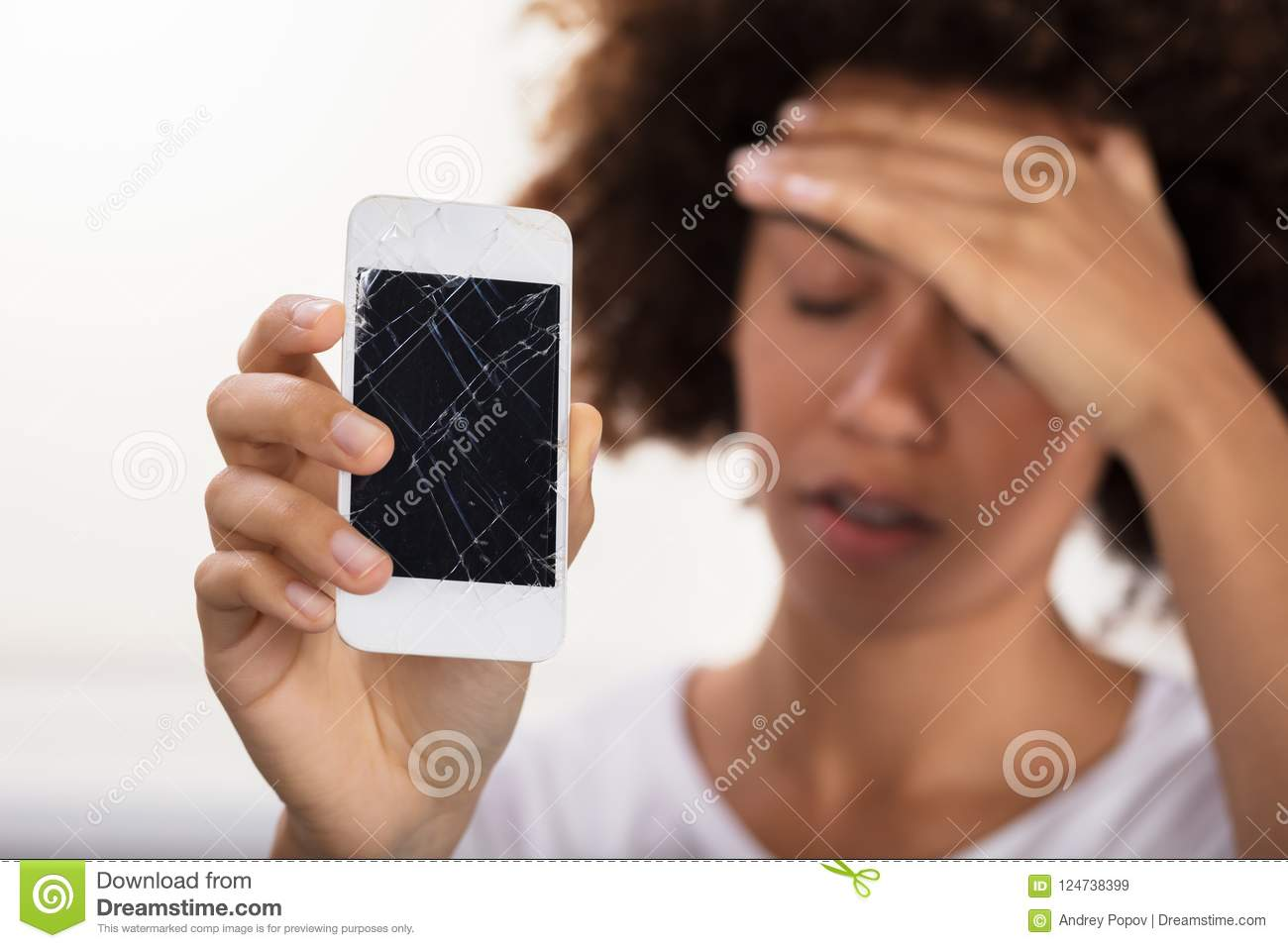 Woman Holding Broken Mobile Phone