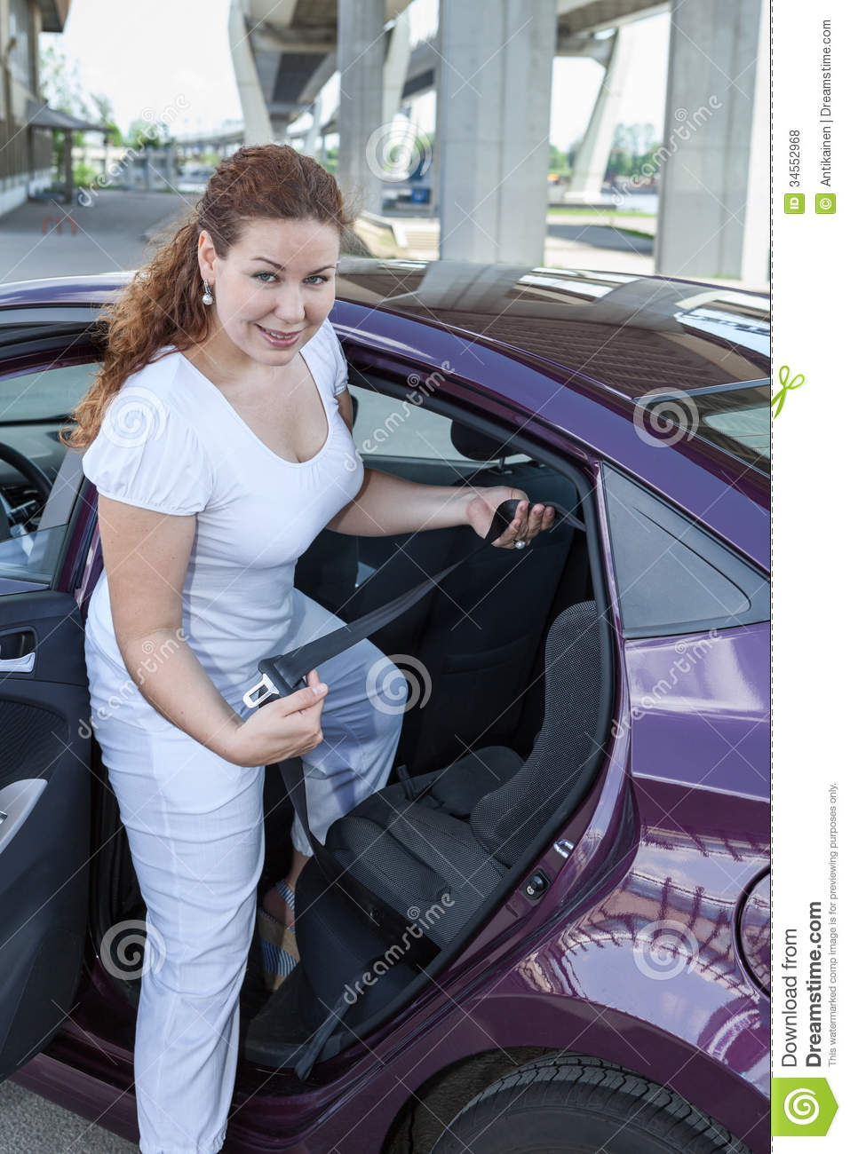 Woman Holding Buckle Of Infant Safety Seat Royalty Free