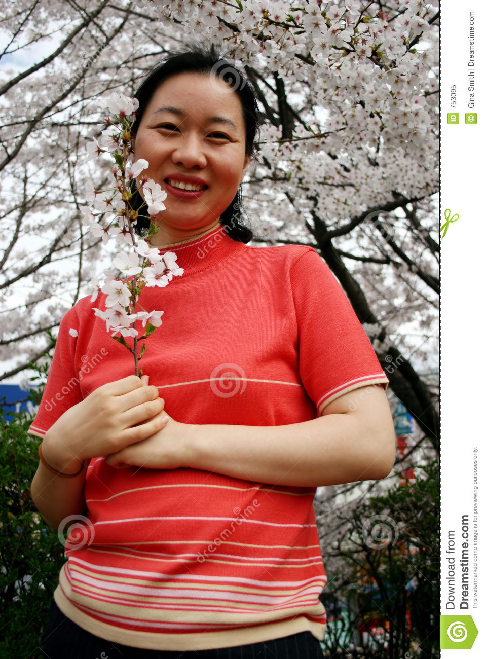 Woman holding cherry blossoms