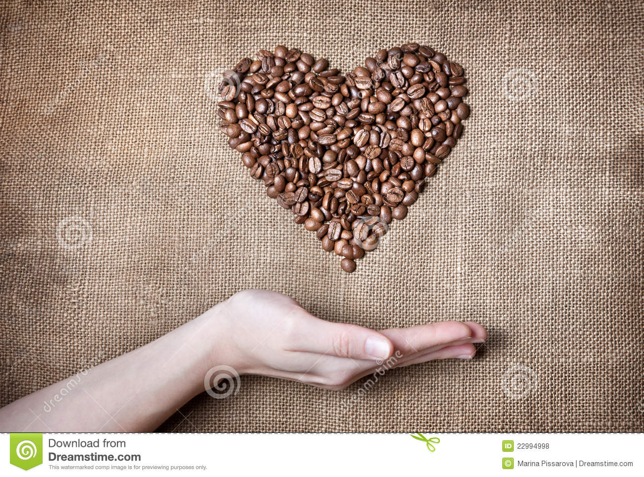 Woman holding coffee Heart