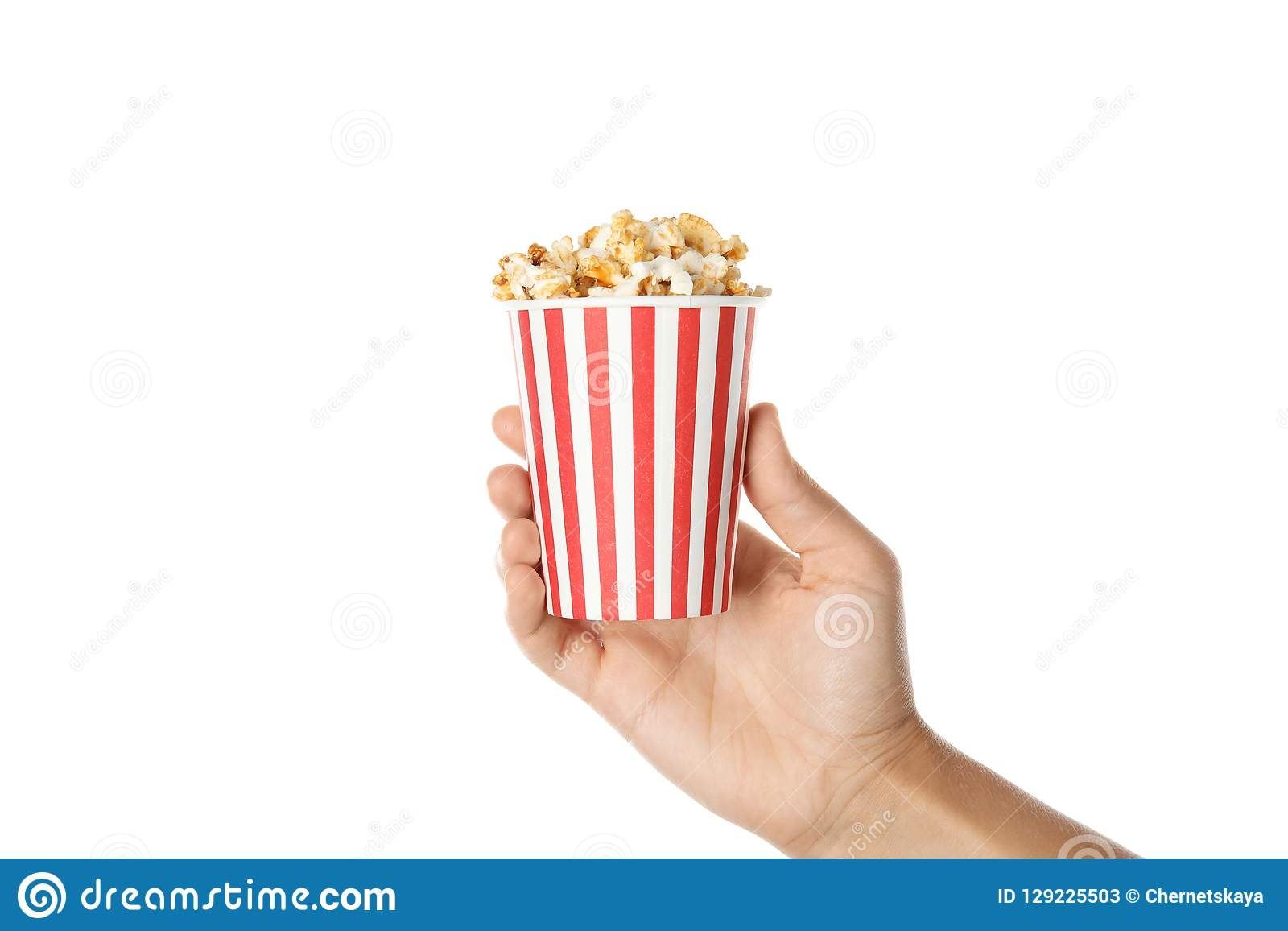 Woman holding cup with delicious popcorn on white background