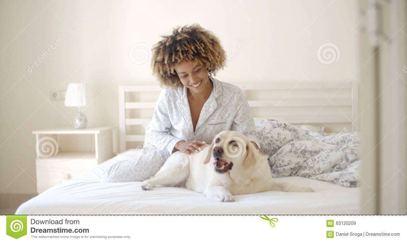 Woman Is Holding A Dog On A Bed Stock Photo Image 63120209