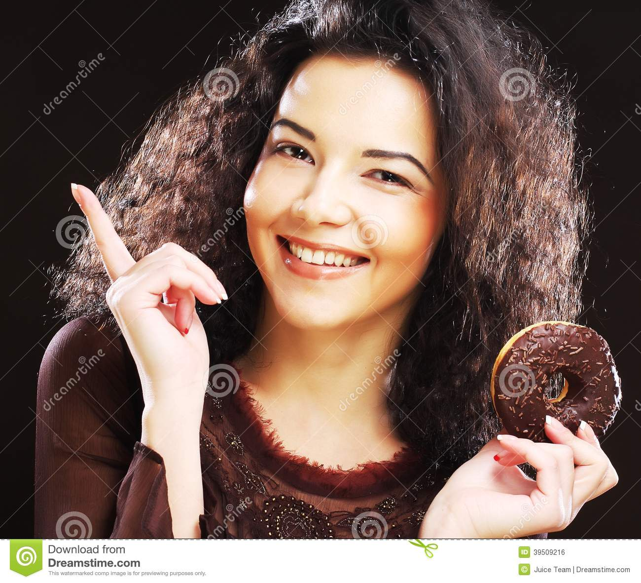 Woman holding a donut