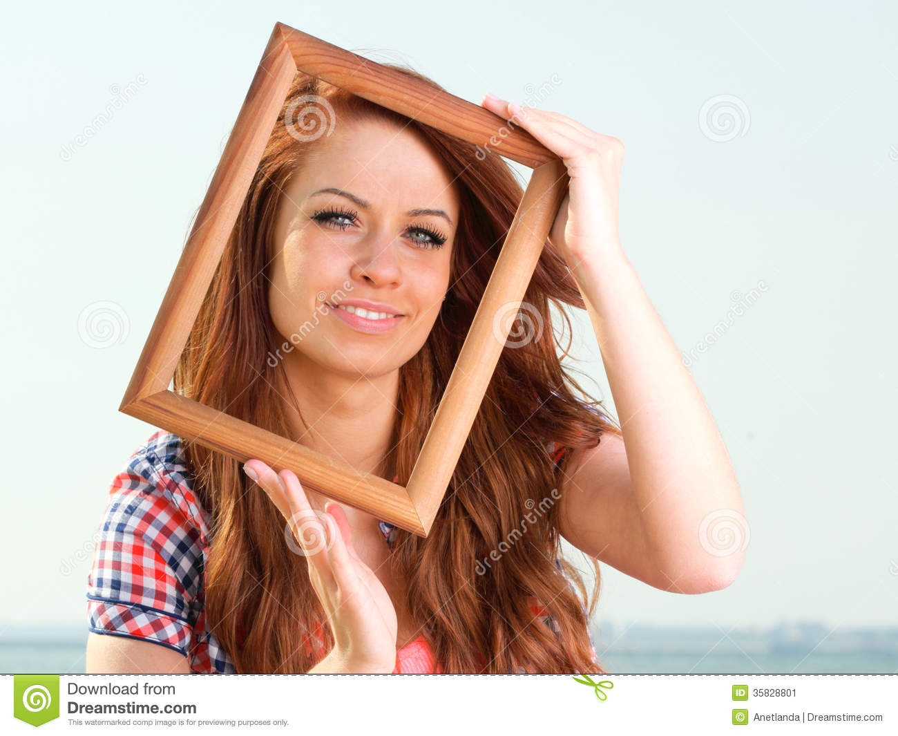 Woman Holding Frame travel concept