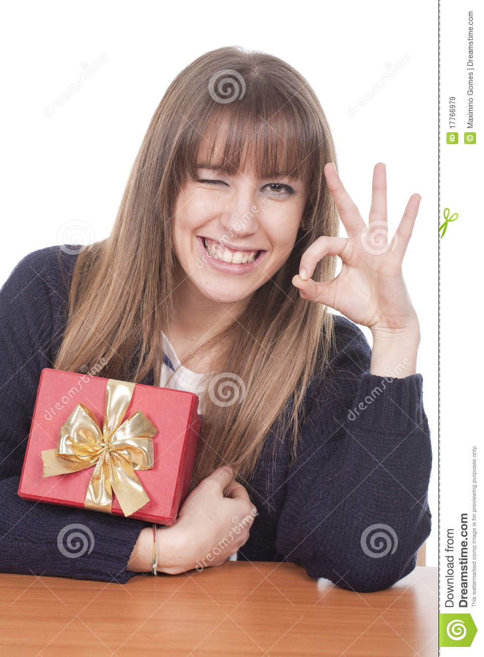 Woman Holding A Gift Box And Smiling Royalty Free Stock ...