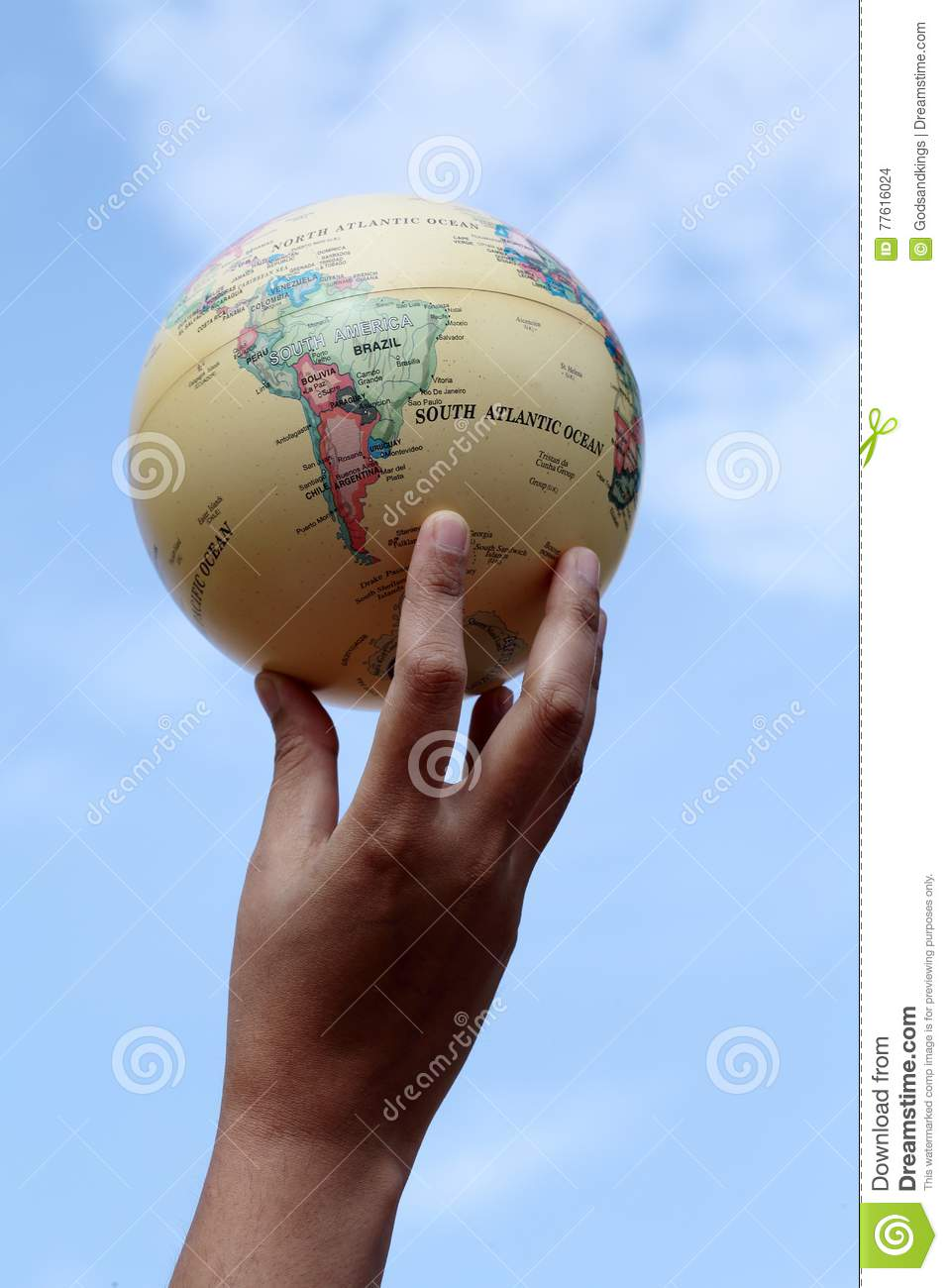 Woman holding globe on her hands