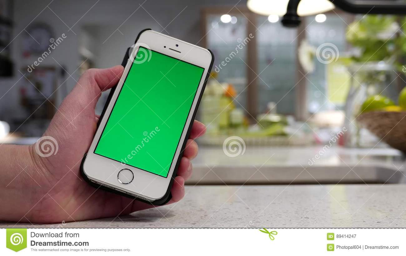 woman holding green screen iphone with blurry dining room stock video video of motion business 89414247